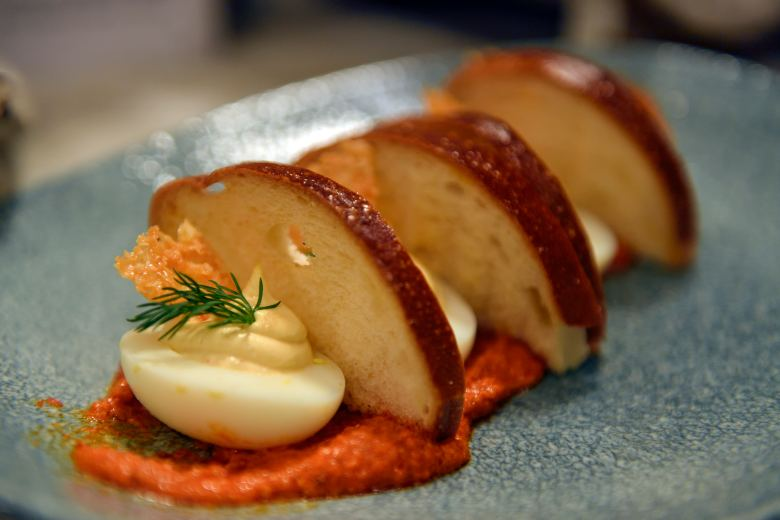 Deviled eggs with toast points and romesco sauce